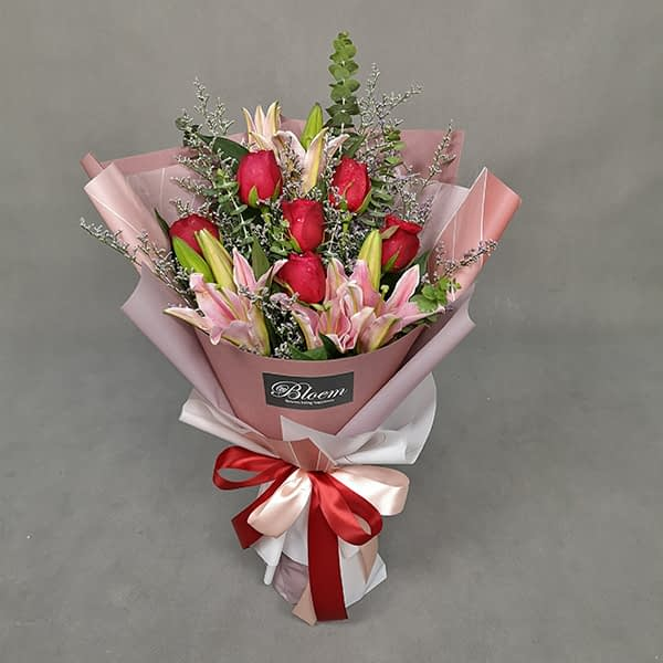 HB238 1 Rm250 Pink Lilies 6 Red Roses with Caspia and Eucalythus