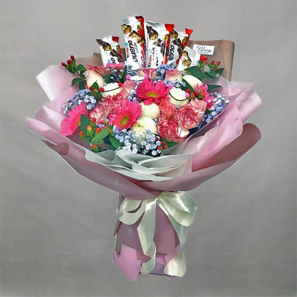 Flowers bouquet with chocolate